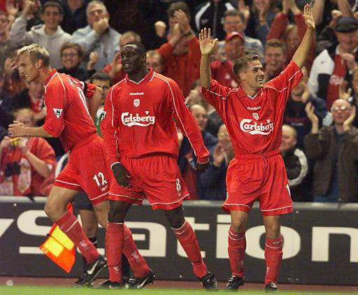 Michael Owen celebrating his goal with his teammates against Aston Villa