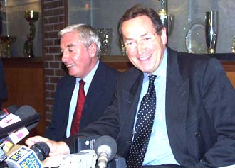 Houllier and Evans at a conference