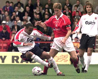Ince tackled by a Man Utd player