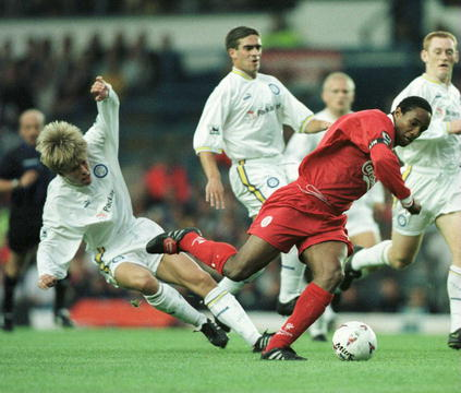 Ince surrounded by Leeds United players