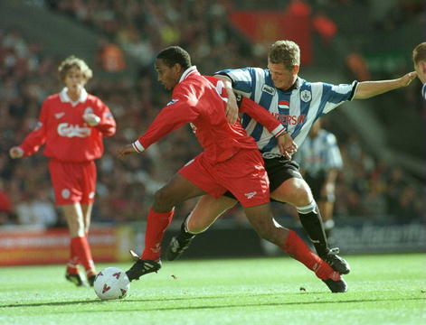 Ince tackled by a Sheffield Wednesday player