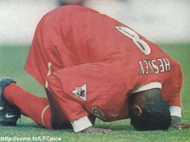 Emile putting his head on the grass