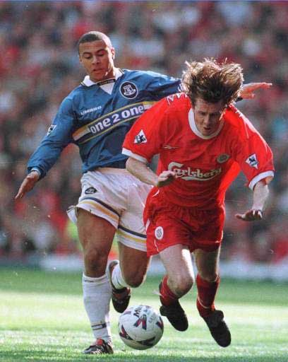 Macca tripped by an Everton player